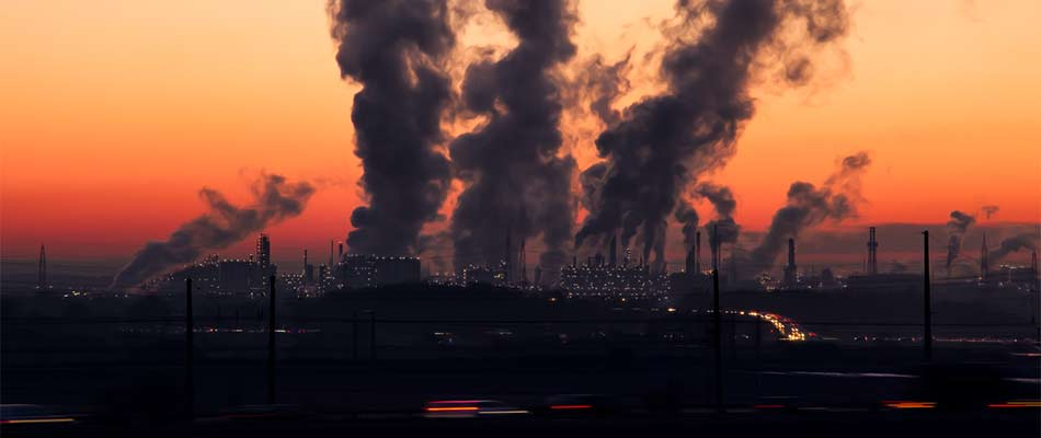 Factories polluting the air with harmful emissions.